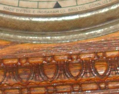 Here you can see the maker's name & the intricate woodwork